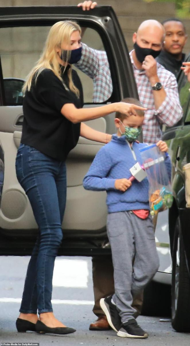 Kid clothes:She was pictured getting out of her SUV with Joseph, who himself was dressed casually in a blue sweater, gray sweats, sneakers, and a colorful mask
