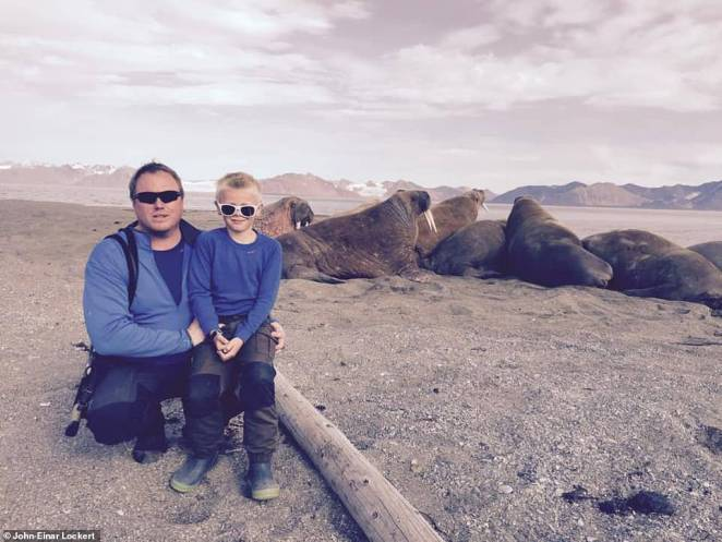 John-Einar is pictured here with his son in front of a herd of walruses. John-Einar describes Svalbard as a 'wonderful place'