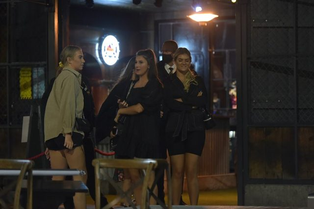 Staff pictured clearing away glasses in Newcastle as the pubs and bars closed up at 10pm as part of new lockdown measures