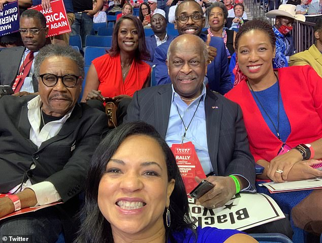 Hermain Cain (center), a prominent Republican businessman and fervent Trump supporter, died of COVID-19 after attending a campaign rally in Tulsa, Oklahoma