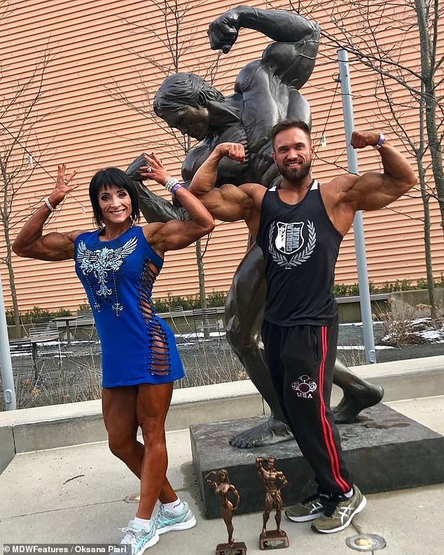 Shared passion: Artem is just as fit as his muscular wife, and they have both taken home bodybuilding trophies
