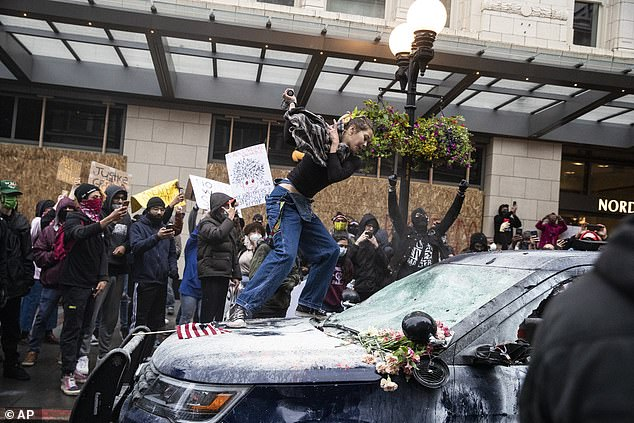 May 30 was the first day of protests in Seattle, pictured. There have been 19,000 complaints of police misconduct against protesters since then, 13,000 of them regarding the boy