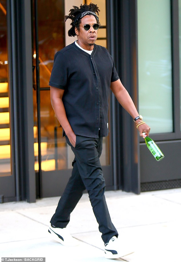 Weekend begins: Husband Jay-Z, 50, was later seen cutting a casual chic look in black, as he left his NYC office on Friday