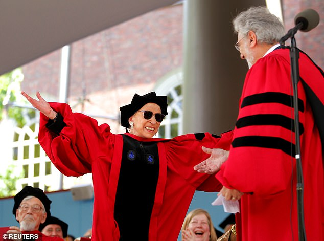 Supreme Court Justice Ruth Bader Ginsburg (center) hugs tenor Placido Domingo after Domingo sang a portion of Ginsburg's citation for her honorary Doctor of Laws degree, during the 360th Commencement Exercises at Harvard University in Cambridge, Massachusetts, in 2011