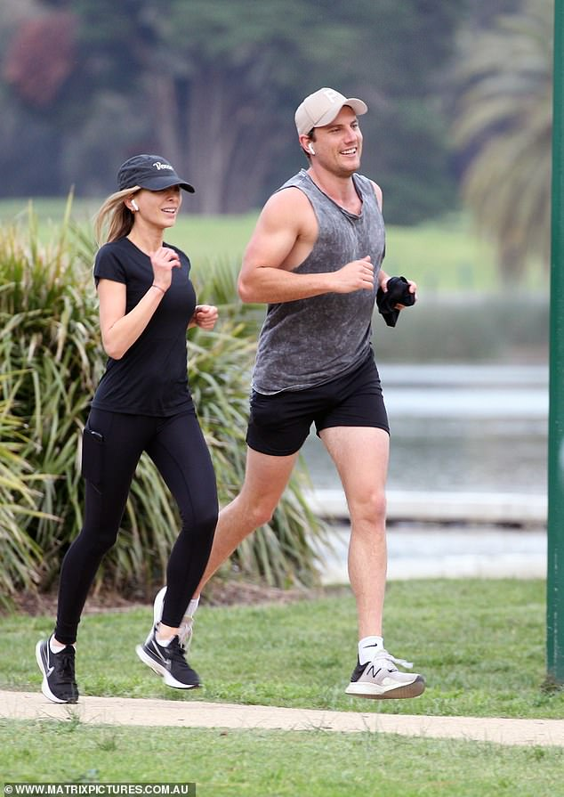 PICTURE EXCLUSIVE: Jimmy who? On Friday, Nadia Bartel debuted her romance with buff 'new boyfriend' Nathan Brodie (pictured) as they went for a run in Melbourne's Albert Park
