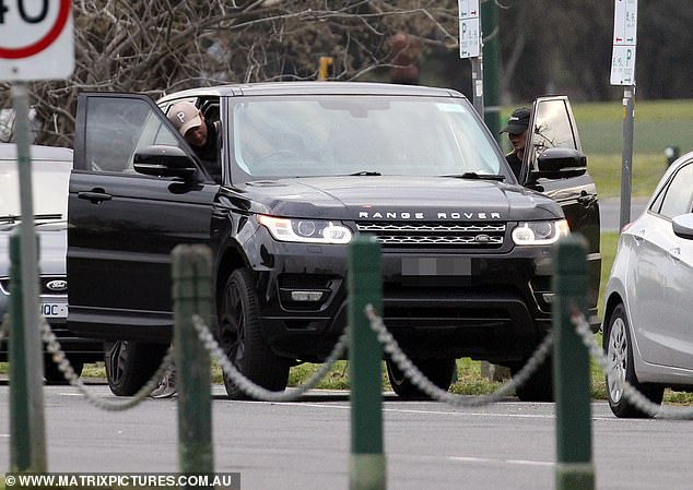 Luxury wheels: The pair were seen getting back inside Nathan's Range Rover