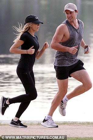 Pounding the pavement:Keeping up: Nadia had no problems keeping up with her athletic beau as they jogged through the park