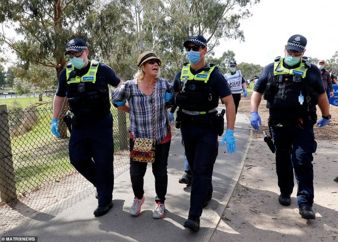 The first protest kicked off at the State Library from 11am, with a second shortly after at 12pm. Pictured: A woman being arrested