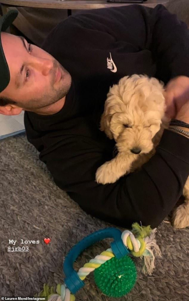 Sweet: Lauren also shared a photo of Jimmy cuddling the pup, along with the caption, 'my loves'