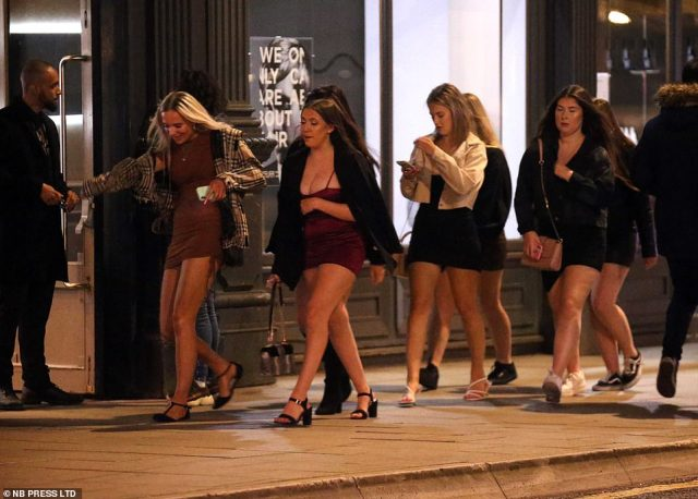 A group of revellers head out into Leeds city centre on Friday night as the city is still on the high at risk category