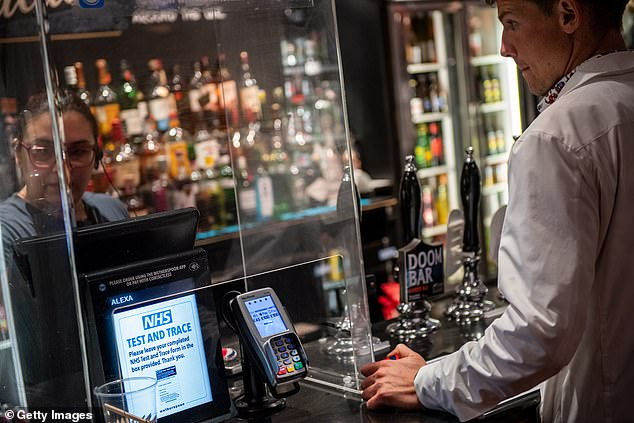 Campaign for Real Ale, which promotes pubs across Britain, has warned that a second national coronavirus lockdown could see pubs closing for good across the UK. Pictured, The Montagu Pyke in London on July 4