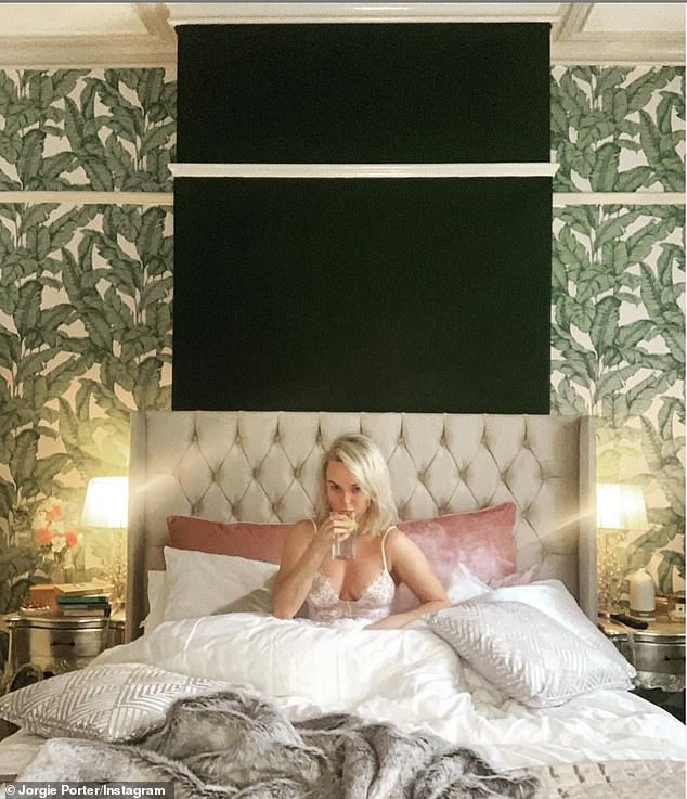 Sleepy Saturday: Jorgie Porter has been sharing snaps of herself sporting a low-cut lingerie top in her giant new double bed