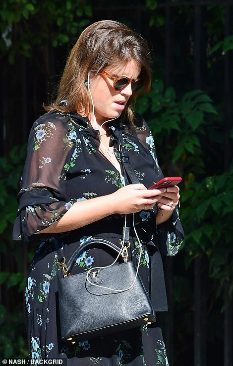 Keeping the look low-key, Eugenie wore a natural make-up look, and kept her auburn hair down and loose