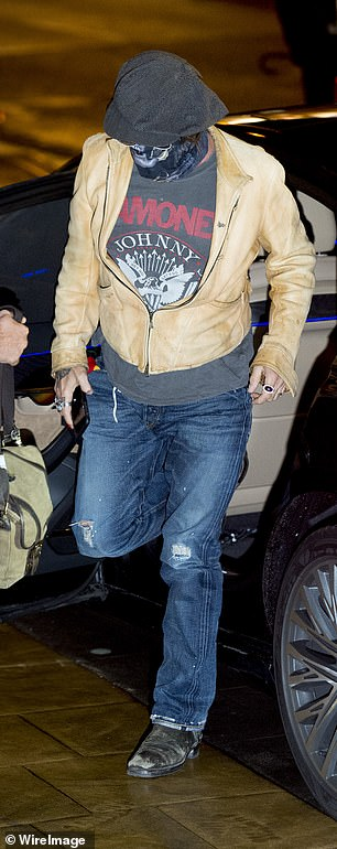 Eclectic: The Edward Scissorhands star layered his look with a suede jacket and teamed it with a pair of distressed blue jeans and black boots