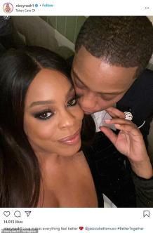 Here we go and the devil is a lie: Niecy Nash receives a kiss from wife Jessica Betts as she recovers from a broken foot