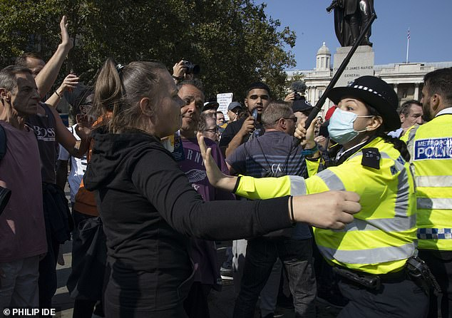 At 2.55pm Scotland Yard issued a statement saying officers had attempted to 'encourage' the protesters to leave but that they remained and were putting themselves and others at risk