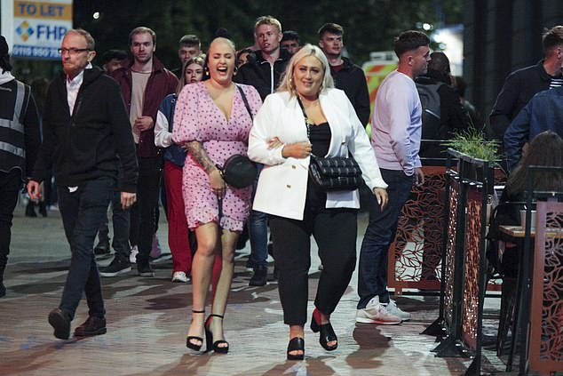 Drinkers are seen out on the town in Nottingham on Saturday. Fears of a second wave of coronavirus have prompted Boris Johnson to institute harsh new rules to limit the virus' spread. But some in his party are displeased with changes that they feel unfairly restrict the freedom of their constituents.