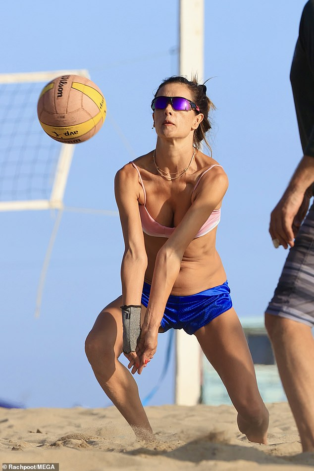 Going full in:Alessandra protected her wrist with a grey brace while hitting around the volleyball as well