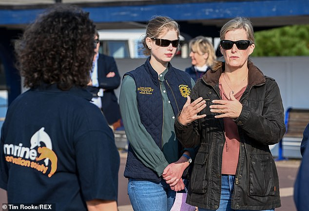 Lady Louise matched her mother, donning a pair of blue skinny jeans and green shirt paired with a body warmer and black sunglasses