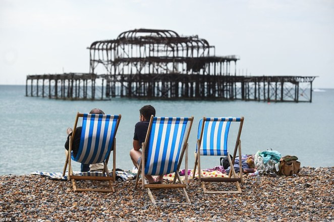 People enjoy the warm weather on Brighton Beach. Daytrippers clogged up coastal routes including the A23 to Brighton, A31 to Dorset and A30 to Cornwall