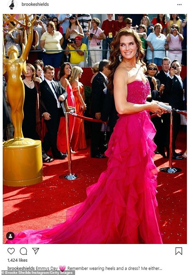 'Remember wearing heels and a dress? Me either...' theBrooke Shields cheekily captioned a snap of herself in hot pink ruffled Badgley Mischka dress from 2008