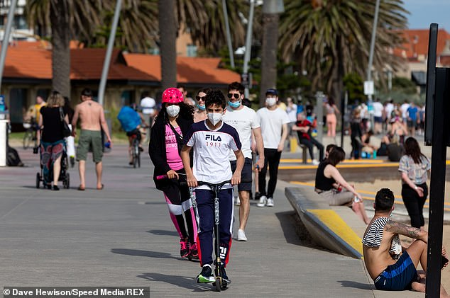 Children on scooters enjoy the warm weather at Elwood Beach in Melbourne over the weekend