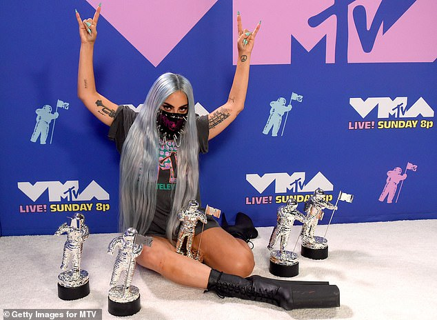 Winning winner: But she has since found a way to overcome her depression, thanks to her latest album, which recently won her three MTV Video Music Awards (pictured in August 2020)