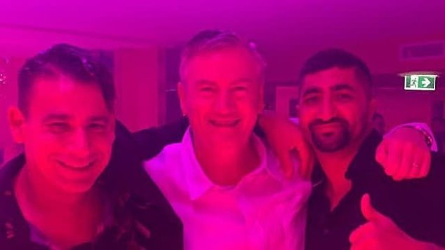 Eddie McGuire (centre) was slammed after he was pictured partying at the Pink Flamingo on Saturday night with nightclub identity Joey Lamattina (left) and lawyer Ashkan Tai (right)