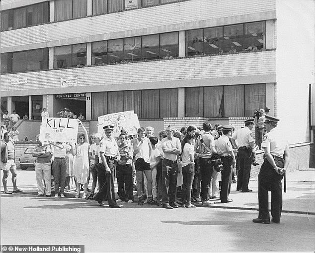 An angry crowd congregates outside the Blacktown police station as news breaks of the arrest of the five men who raped and murdered Anita Cobby. This images was taken on 24 February 1986, almost three weeks after the nurse was killed at Prospect in far western Sydney