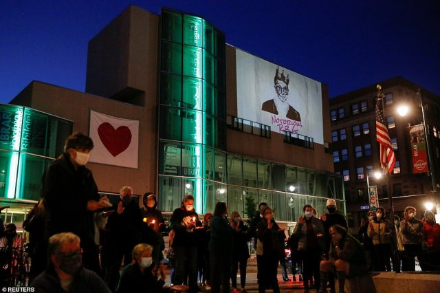 MAINE: Mourners lit candles while Ginsburg's image was projected onto the side of a building alongside her nickname the 'Notorious RBG'