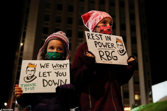 MAINE: Mourners including children held up banners with slogans including 'We won't let you down' and 'Rest in power RBG'