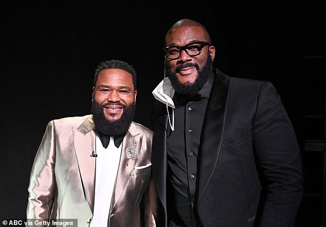 Bearded duo: Perry also bumped into Black-ish star Anthony Anderson, who presented Watchmen with the Emmy for outstanding limited series