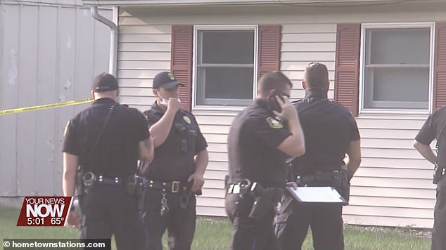 Police officers outside the couple's home on West Ford Avenue, Lima, after the shooting