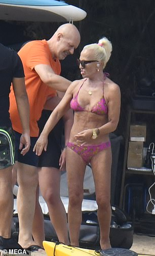 Talkative: Donatella was seen chatting away with her friend