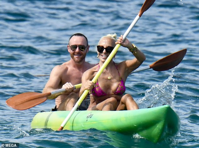 Beaming: Donatella was in great spirits as she canoed with her pals