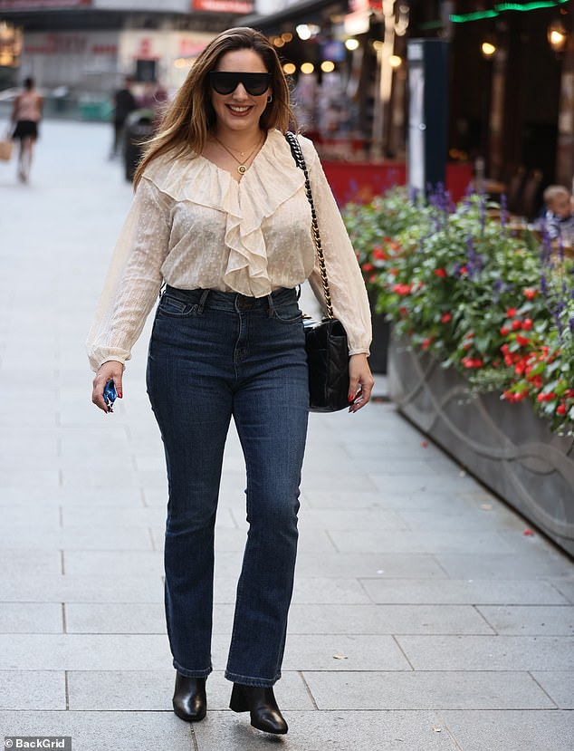 Lovely:Kelly completed her stylish ensemble with black sunglasses and chain-strapped sunglasses as she headed into the radio studio