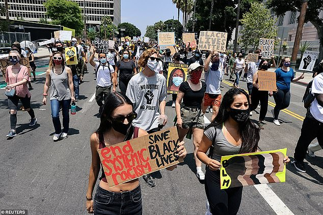 California has seen near-continuous protests against inequality and police brutality that began in May after the death of George Floyd (pictured, marchers in LA the day before the shooting)