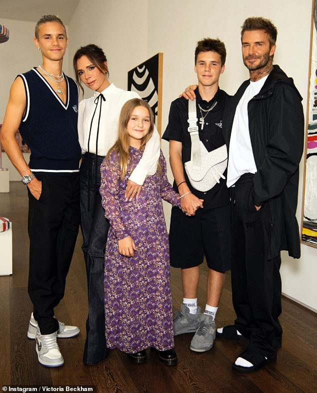 Happy: Victoria Beckham was supported by husband David and their family on Monday as she prepared to unveil her digital presentation for London Fashion Week