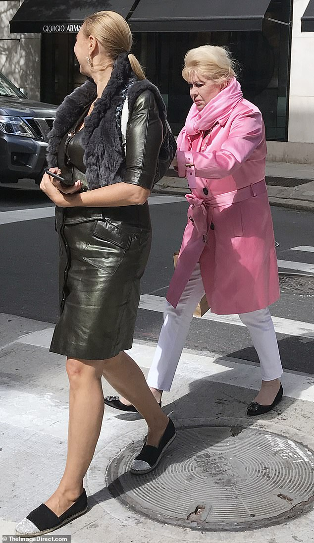 Support: Ivana held onto her friend's arm as they walked past the high-end stores in the famous shopping district. Neither of them wore protective face masks