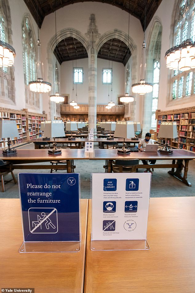 The site We Rate COVID Dashboards was founded by researchers from major universities including Harvard and Yale as students started returning to campuses across the country. Pictured is the library at Yale University with social distancing measures in place
