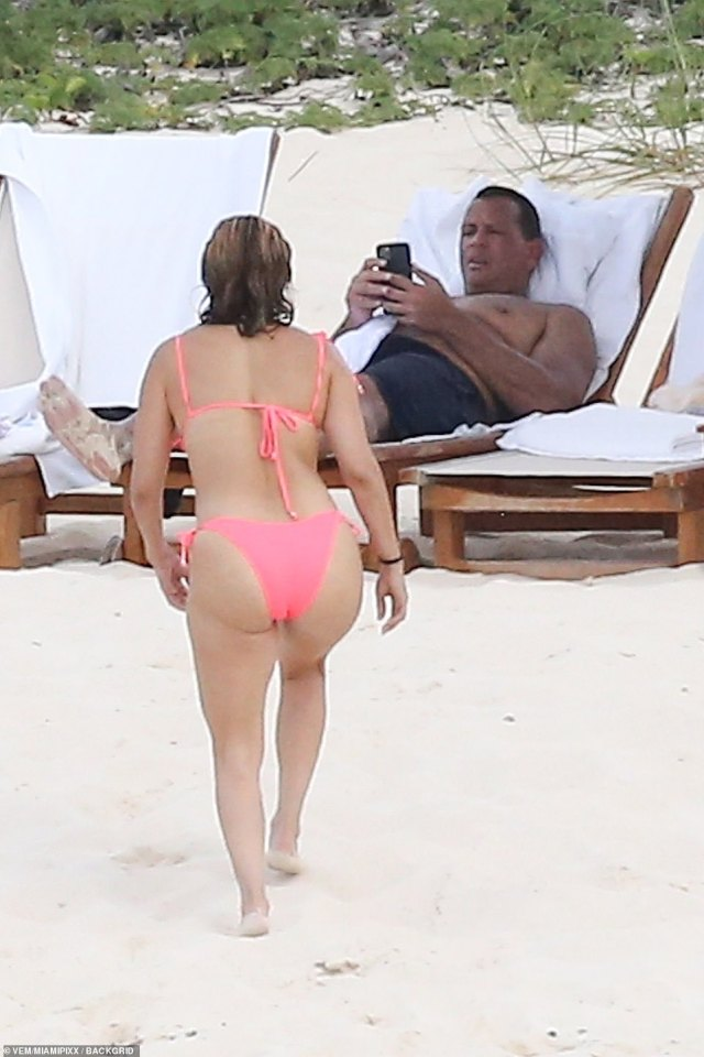 Back on land: ARod waited for his fiancee on the sand