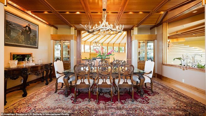 The dining room features multiple examples of the home's furniture-grade woodwork. The home was built by a local contractor, who sold it while he was going through a divorce