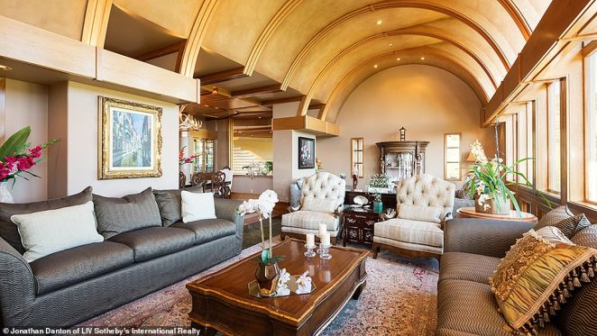 The 14,000-square-foot home has eight bedrooms, a living room, gym, wine cellar and dining room among its features