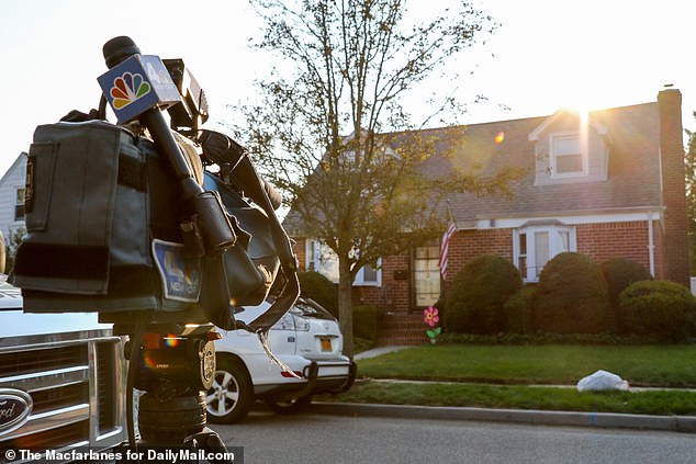 News crews set up cameras outside Angwang's home in Long Island on Monday
