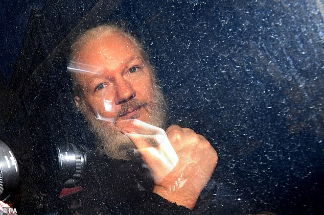 Pictured:Assange arriving at Westminster Magistrates' Court last year