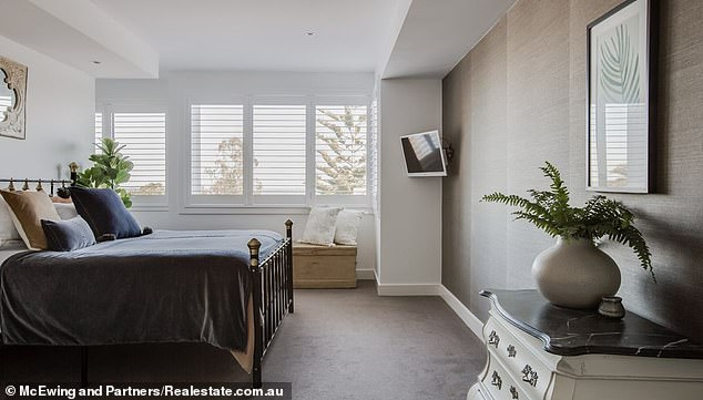 The four bedroom home in Balnarring Beach is tucked away in a secluded spot with native gardens at the front which open onto the sand dunes directly from the backyard