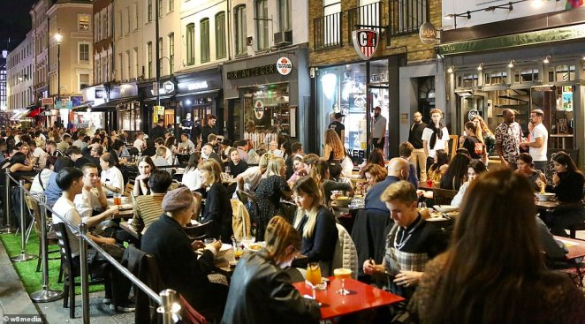 Ministers have been warned that a 10pm curfew on pubs and restaurants will be the 'final nail in the coffin' for many businesses still treading water after the initial shutdown (pictured in Soho last night)