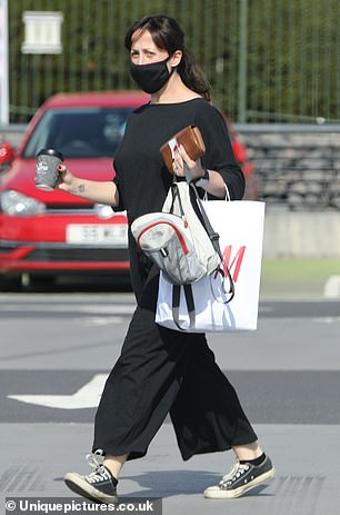 Shopping trip: Natalie styled her glossy brunette locks into a high ponytail fastened with a denim scrunchie