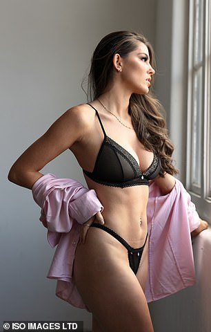 Sizzling: Rebecca's barely-there underwear showcased her sizzling figure as she posed up a storm for the new shoot, showing off her ample assets and toned abs