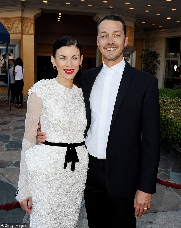 Over: Rupert Sanders made headlines in 2012 after he was photographed with Kristen Stewart, who was the star of his film Snow White and the Huntsman. The photographs led to the eventual breakdown of his marriage to model Liberty Ross (left)